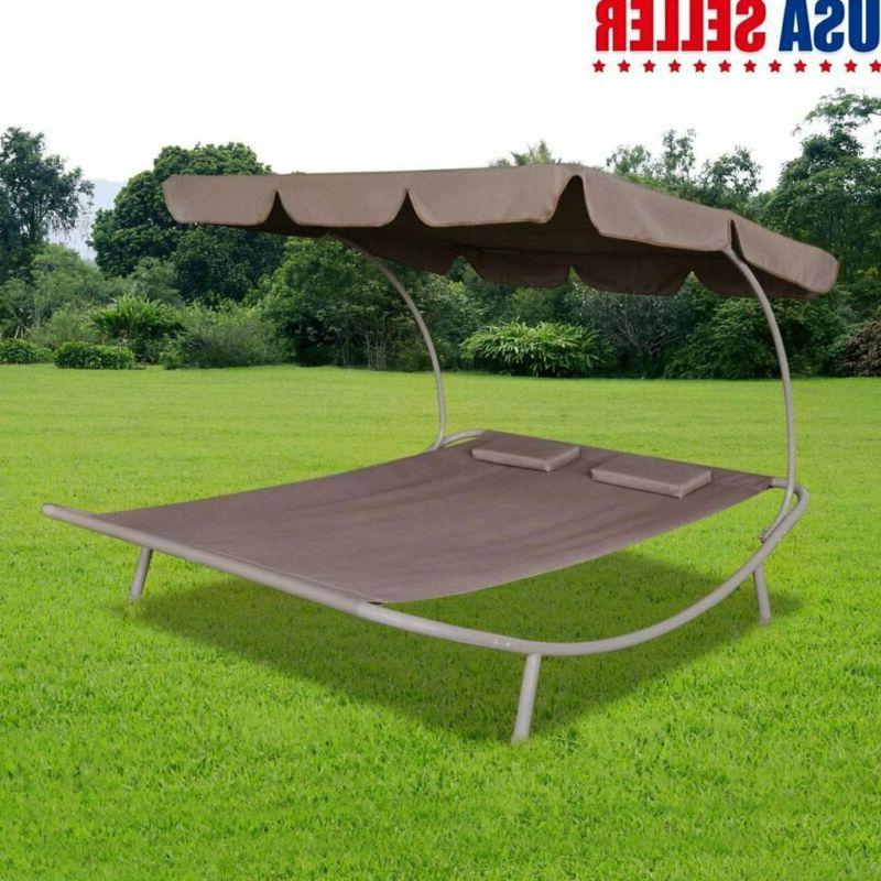 outdoor lounge bed with canopy and pillow